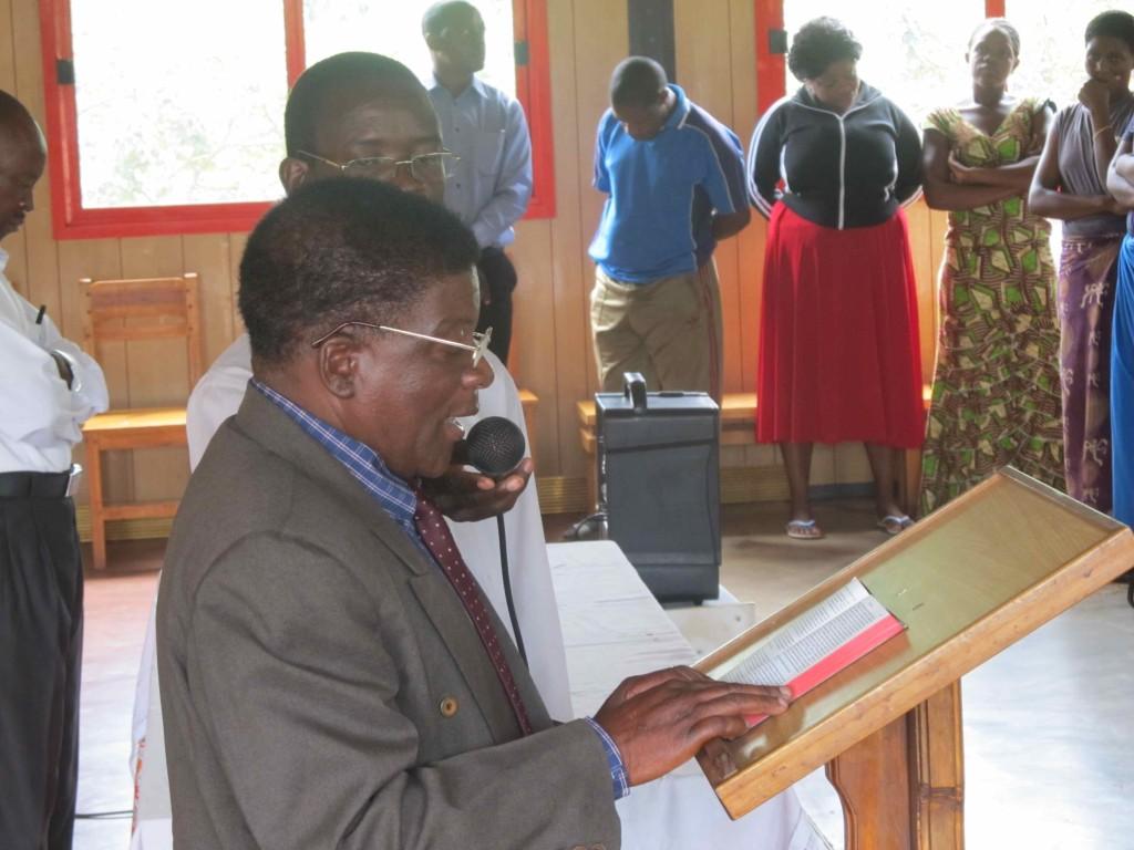 Murowa reading the Gospel