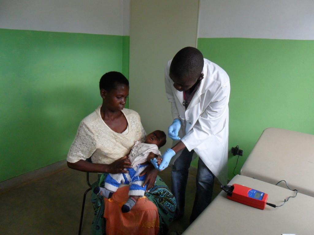 A nurse uses the Hemocue on patient