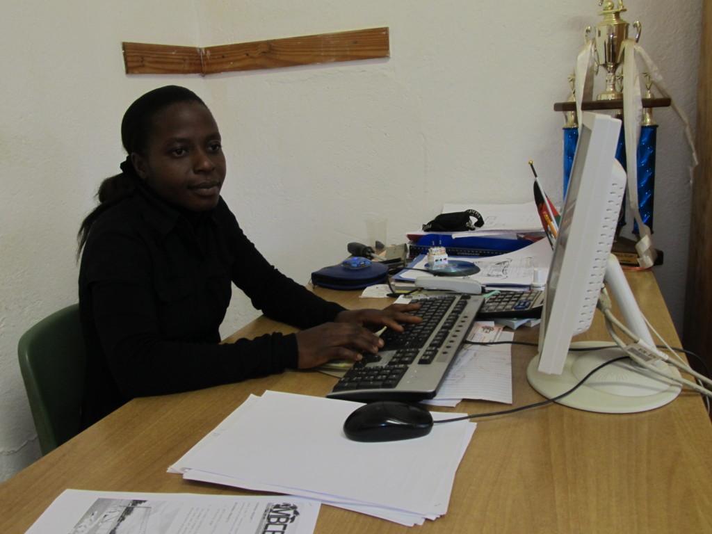 Loyce Phuka on her desk