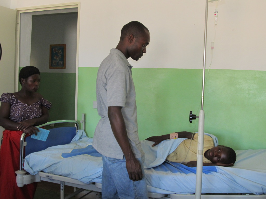 Mr. Munthali and Mrs. Masauko at Martin's bedside