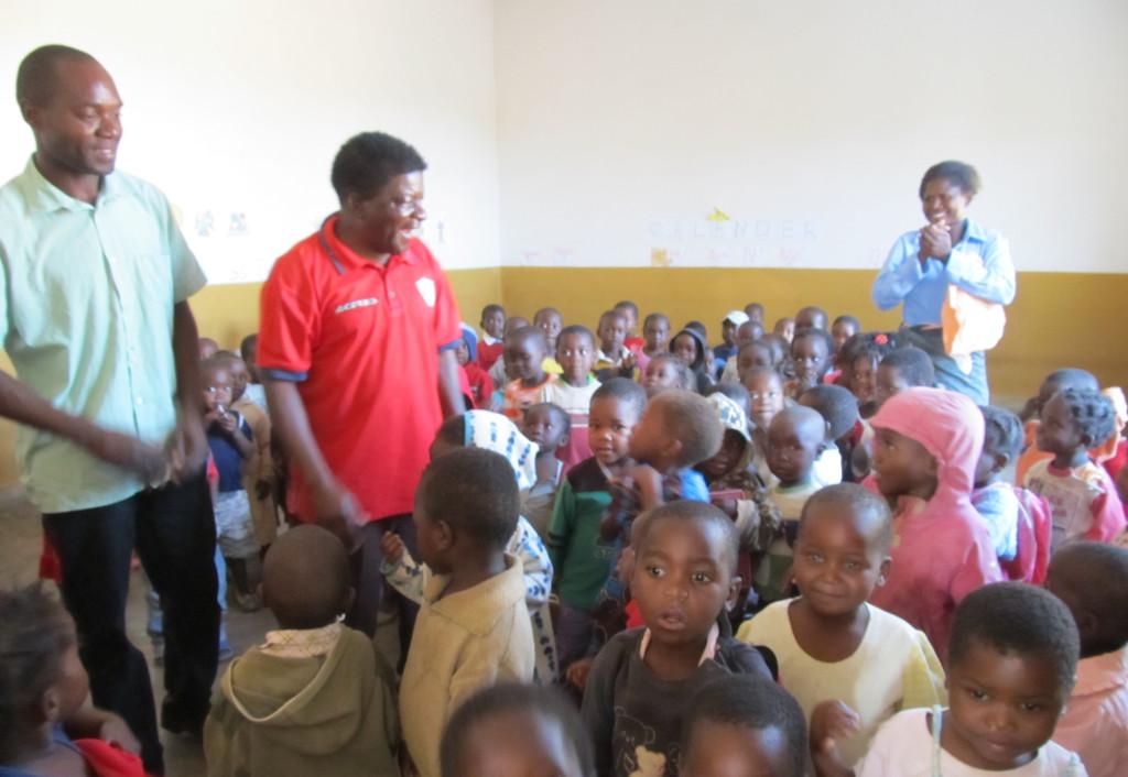 Mr. Munthali (L) and Mr. Murowa (R) with the nursery  school kids at St. John's in Mpulula