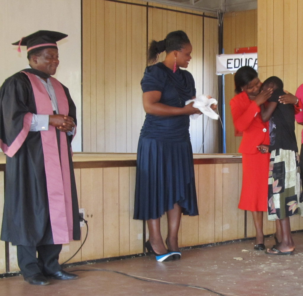 Mr. Murowa, Christabel and Mrs. Mpetiwa presenting gifts and testimonials