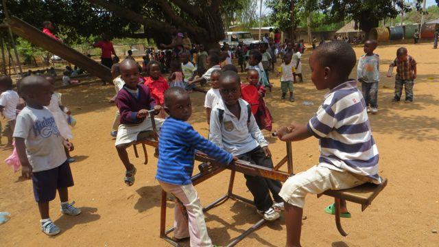 Kids enjoying see saw