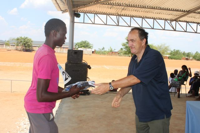 Individual athletes receiving their prizes to Don Cesare