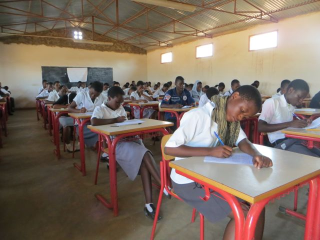 Form III students writing their exams