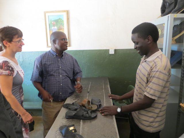 Chimwemwe Mwenyemasi showing the Likambales the work of his hands