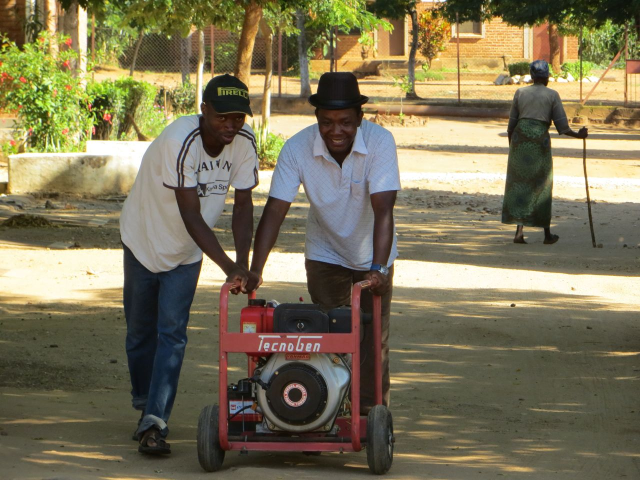 Alleluya band members returning the generator to the main store