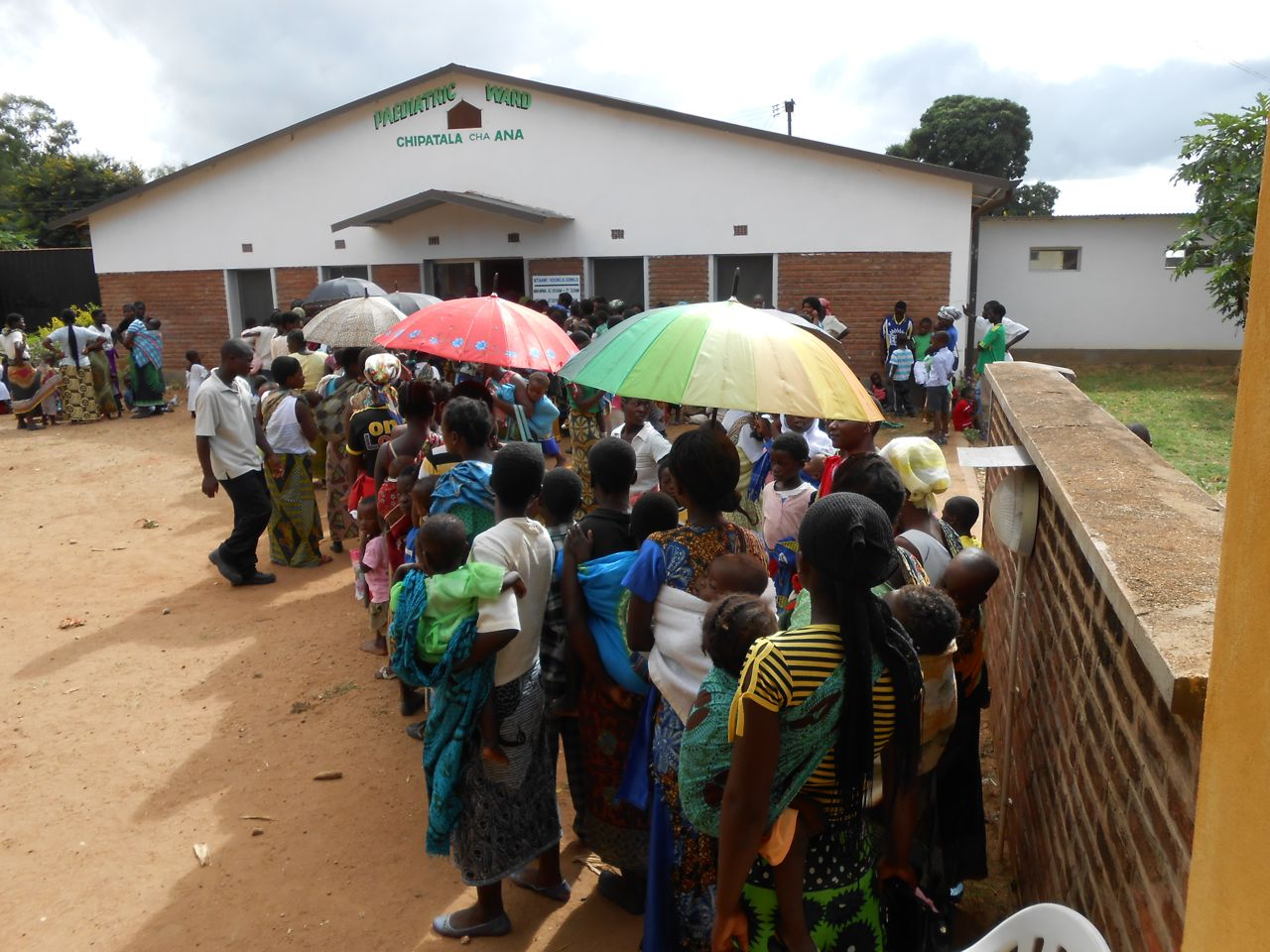 Guardians and patients queueing for drugs