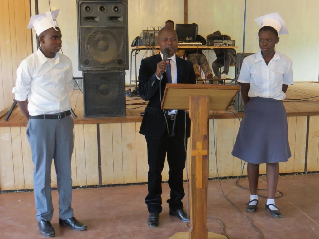 Meleka congratulating students with many awards