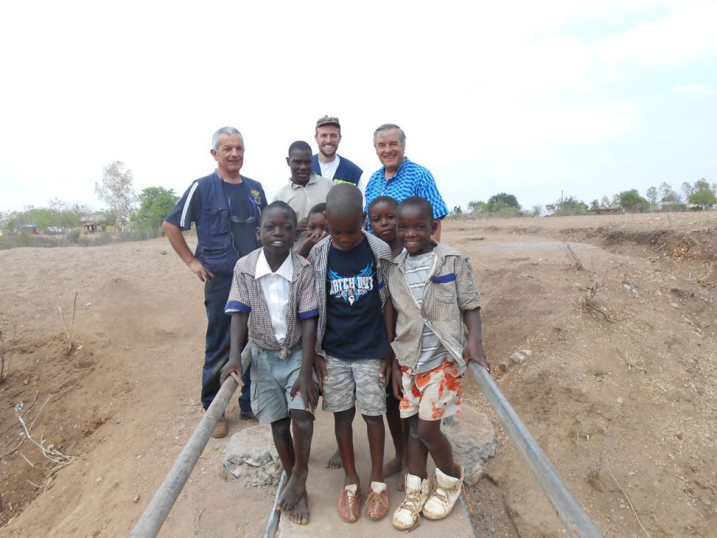 A pose with some of the beneficiaries of the bridge