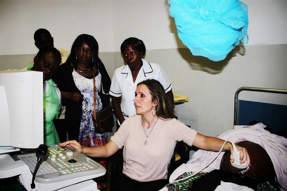 From Left to Right:  Nurse M. Kholiyo, Dr. Gloria Esegpona, Nurse C. Nkando, Dr. Elena Geco (performing the ultrasound)